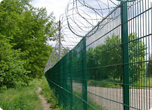 Razor wire install on welded wire fence